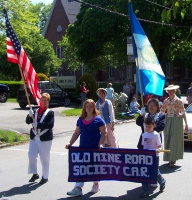 Chapter members march with Children in Memorial Day parade.